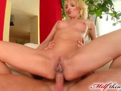 Blonde is giving a deep blowjob