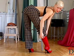 Blonde Maya is posing in her nice bloody red boots