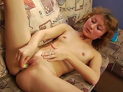Redhead will fill her pussy with anything