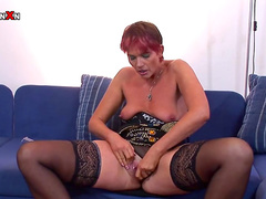 Redhead Lily is sucking dick and masturbating