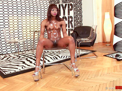 Oiled ebony Jasmine shows off her ass and small tits