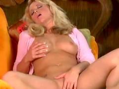 Horny as hell blonde Holly Morgan is masturbating her puss