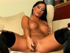 Pretty tanned brunette Claudia Capri bangs her holes