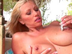 Blonde Nikita Valentin masturbates her puss outdoors