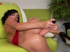 Joan Mueur is fucking her lovely shaved pussy