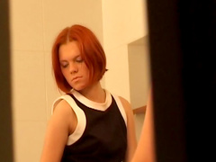 Redhead Emily masturbating in the bathroom