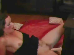 Milf penetrates her own pussy