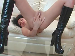 Latex boots on cute fingering slut