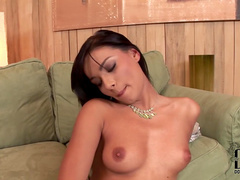 Angel Pink poses and shows her slender shape