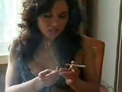 Dark-haired chick gives a us a touch of fetish