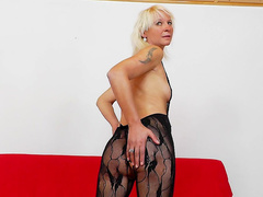 Mature blonde Bernadeta masturbates in her nylons
