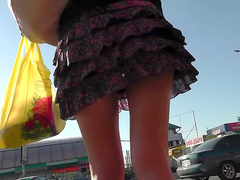 Cute outdoor upskirt with a sexy beauty