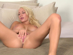 Blonde with pretty face Devon Alexis is masturbating