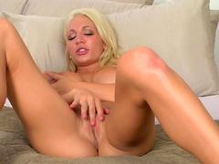 Blonde with pretty face Devon Alexis is masturbating