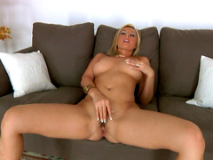 Blonde Daria Glowe is poking her trimmed pussy with toys