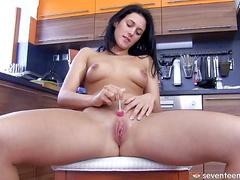 Hot brunette Betty K in the kitchen