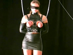 Leather and latex girl in BDSM video