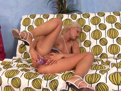 Busty blonde Bridget pokes herself with dildo