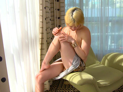 Hot blonde Livia Godiva is masturbating her nice shaved pussy