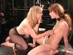 Blonde milf spanks her busty slave