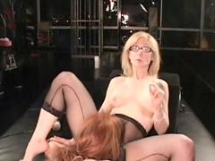 Blonde milf spanks her busty slave