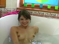 Stunning short-haired brunette smoke in the bath