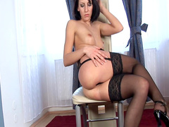 Tight temptress in stockings masturbates
