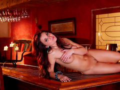 Mariela Henderson is posing naked in the bar