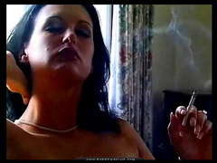 Tendrils of smoke leave her lips