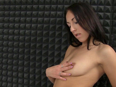 Dark-haired lady shows off her cute shaved puss