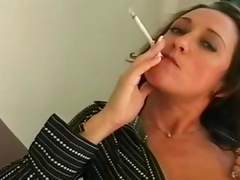 Sexy smoking with sensual brunette