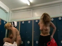 Sexy blonde shows her tits in the locker room