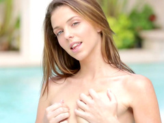 Kiera Winters poses naked at the poolside