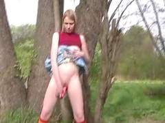 Solo scene with skinny blonde outdoors