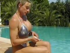 Muscular milf in shiny bikini lesbian sex