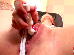 Brunette Nikita is masturbating in her office