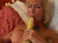 Slim sexy mature in stockings laid