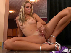 Blonde Erica Lightspeed is playing with her ass