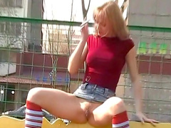 Blonde is fucking her tight puss outdoors