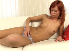 Redhead babe Anna Flames is sucking her nice dildo