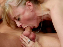 Nina Hartley is giving a professional blowjob
