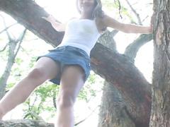 Teen climbs tree and reveals upskirt