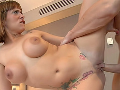 Tattooed tummy on a busty fuck slut