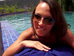 Curious brunette Lily Love with glasses is giving amazing blowjob in the poolside
