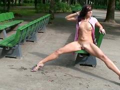 Skinny slut flashes pussy in public