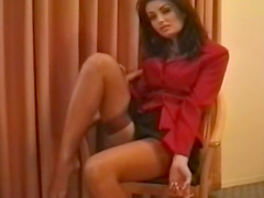 Brunette lady is smoking a cigarette so sexy