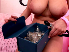 Sweet blonde Katarina is posing and playing with vacuum toys