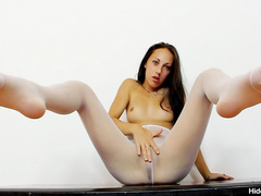 Drunk angel in white stockings is satisfying her pussy