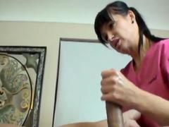 Milf brunette is giving a professional handjob