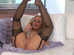 Nicole Aniston is sucking her nice dildo